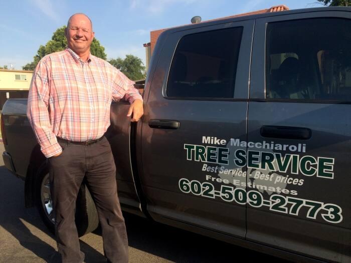 Mike Macchiaroli standing in front of his truck